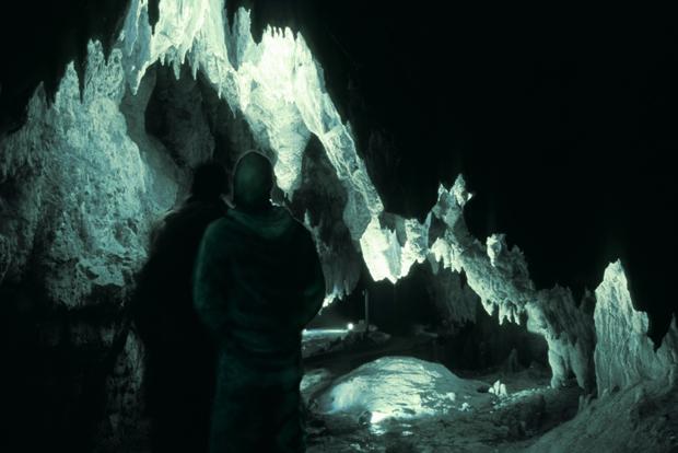 illuminated stalactite cave