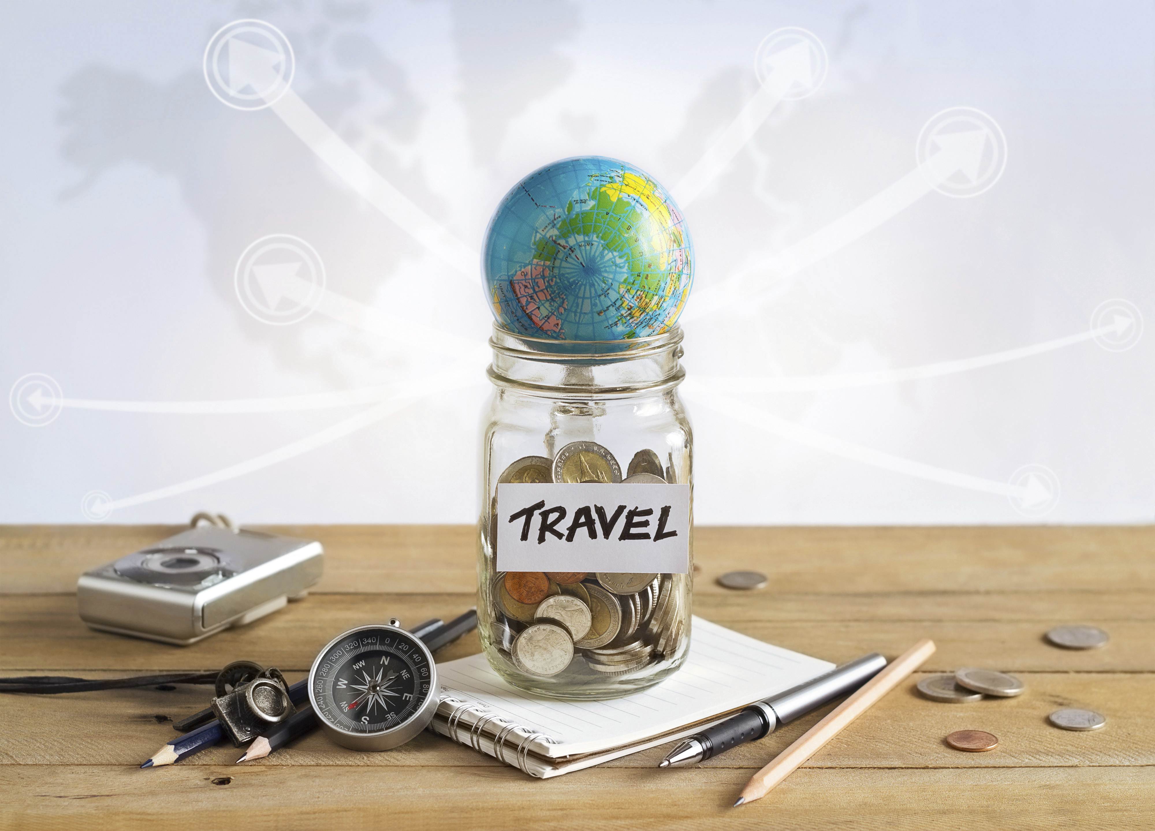 Money savings in a glass jar on world map background, Travel co